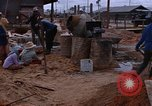 Image of mixing cement Thailand, 1966, second 61 stock footage video 65675042839