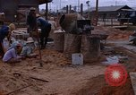 Image of mixing cement Thailand, 1966, second 62 stock footage video 65675042839