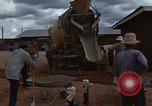 Image of pouring cement Thailand, 1966, second 29 stock footage video 65675042841