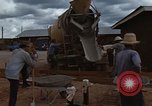 Image of pouring cement Thailand, 1966, second 30 stock footage video 65675042841