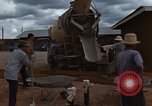 Image of pouring cement Thailand, 1966, second 31 stock footage video 65675042841