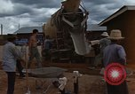 Image of pouring cement Thailand, 1966, second 32 stock footage video 65675042841