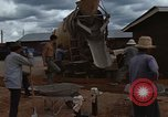 Image of pouring cement Thailand, 1966, second 33 stock footage video 65675042841
