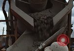 Image of pouring cement Thailand, 1966, second 40 stock footage video 65675042841