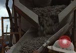 Image of pouring cement Thailand, 1966, second 41 stock footage video 65675042841