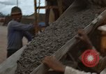Image of pouring cement Thailand, 1966, second 42 stock footage video 65675042841