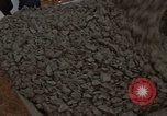 Image of pouring cement Thailand, 1966, second 45 stock footage video 65675042841