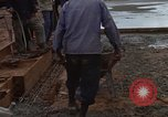 Image of pouring cement Thailand, 1966, second 51 stock footage video 65675042841