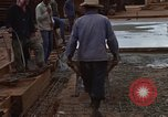 Image of pouring cement Thailand, 1966, second 52 stock footage video 65675042841