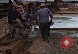 Image of pouring cement Thailand, 1966, second 54 stock footage video 65675042841