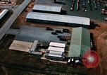 Image of vehicles at air base Thailand, 1967, second 7 stock footage video 65675042844