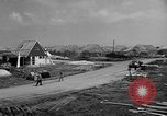 Image of suburban houses New York United States USA, 1950, second 27 stock footage video 65675042887
