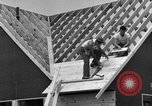 Image of suburban houses New York United States USA, 1950, second 49 stock footage video 65675042887