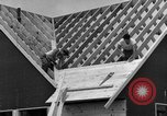 Image of suburban houses New York United States USA, 1950, second 57 stock footage video 65675042887