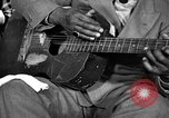 Image of Lead Belly United States USA, 1936, second 17 stock footage video 65675042895