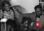 Image of Lead Belly United States USA, 1936, second 52 stock footage video 65675042897