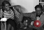 Image of Lead Belly United States USA, 1936, second 53 stock footage video 65675042897