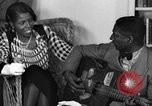 Image of Lead Belly United States USA, 1936, second 60 stock footage video 65675042897