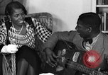 Image of Lead Belly United States USA, 1936, second 62 stock footage video 65675042897