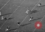 Image of football game Seattle Washington USA, 1957, second 16 stock footage video 65675042905