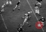 Image of football game Seattle Washington USA, 1957, second 37 stock footage video 65675042905