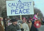 Image of Peace demonstrators march protesting Vietnam War Washington DC USA, 1969, second 2 stock footage video 65675042914