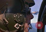 Image of A 1E Skyraider aircraft fire rockets at enemy ground target Southeast Asia, 1966, second 33 stock footage video 65675042960