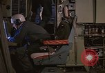 Image of Crew member inside an Air Rescue HC-130H  Southeast Asia, 1966, second 15 stock footage video 65675042965