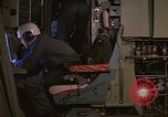 Image of Crew member inside an Air Rescue HC-130H  Southeast Asia, 1966, second 16 stock footage video 65675042965