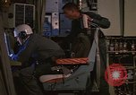 Image of Crew member inside an Air Rescue HC-130H  Southeast Asia, 1966, second 18 stock footage video 65675042965