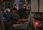 Image of Crew member inside an Air Rescue HC-130H  Southeast Asia, 1966, second 19 stock footage video 65675042965