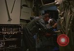 Image of Crew member inside an Air Rescue HC-130H  Southeast Asia, 1966, second 20 stock footage video 65675042965