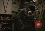 Image of Crew member inside an Air Rescue HC-130H  Southeast Asia, 1966, second 21 stock footage video 65675042965