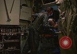 Image of Crew member inside an Air Rescue HC-130H  Southeast Asia, 1966, second 22 stock footage video 65675042965