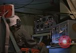 Image of Crew member inside an Air Rescue HC-130H  Southeast Asia, 1966, second 31 stock footage video 65675042965
