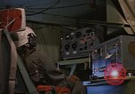 Image of Crew member inside an Air Rescue HC-130H  Southeast Asia, 1966, second 32 stock footage video 65675042965