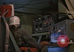Image of Crew member inside an Air Rescue HC-130H  Southeast Asia, 1966, second 49 stock footage video 65675042965