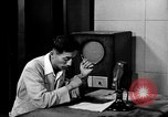 Image of Japanese Station announcer Tokyo Japan, 1945, second 3 stock footage video 65675043008
