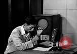 Image of Japanese Station announcer Tokyo Japan, 1945, second 17 stock footage video 65675043008