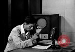 Image of Japanese Station announcer Tokyo Japan, 1945, second 18 stock footage video 65675043008