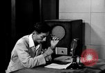 Image of Japanese Station announcer Tokyo Japan, 1945, second 19 stock footage video 65675043008