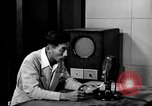 Image of Japanese Station announcer Tokyo Japan, 1945, second 25 stock footage video 65675043008