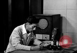 Image of Japanese Station announcer Tokyo Japan, 1945, second 38 stock footage video 65675043008