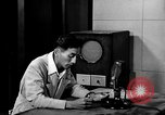 Image of Japanese Station announcer Tokyo Japan, 1945, second 39 stock footage video 65675043008