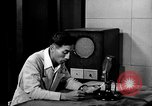 Image of Japanese Station announcer Tokyo Japan, 1945, second 42 stock footage video 65675043008