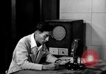 Image of Japanese Station announcer Tokyo Japan, 1945, second 45 stock footage video 65675043008