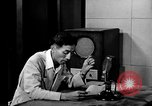 Image of Japanese Station announcer Tokyo Japan, 1945, second 59 stock footage video 65675043008