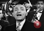 Image of Singer Al Trace in war bond drive United States USA, 1943, second 23 stock footage video 65675043013