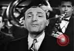 Image of Singer Al Trace in war bond drive United States USA, 1943, second 27 stock footage video 65675043013