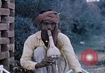 Image of Snake charmer India, 1956, second 1 stock footage video 65675043054